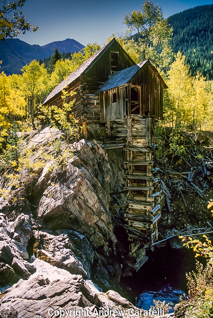 Crystal Mill near Marble, Colorado is surrounded by brilliant aspen trees in the fall.