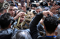 """A statue of Saint Domenico surrounded by live snakes is held up by worshippers during an annual procession dedicated to the saint, in the streets of Cocullo, in the Abruzzo region, on May 1, 2019.<br /> <br /> <br /> <br /> The St. Domenico's procession in Cocullo, central Italy. Every year on the first  of May, snakes are placed onto the statue of St. Domenico and then the statue is carried in a procession through the town. St. Domenico is believed to be the patron saint for people who have been bitten by snakes:<br /> <br /> Italy, Cocullo, in the Province of L'A...quila, is at 870 meters a.s.l., along the railway line connecting Sulmona to Rome. The village rises alongside Mount Luparo (1327 meters) """"The valley opening in front of the village is surrounded by bare rocks, while on the other side, to the south, snow-capped mountain crests follow one after the other...""""<br /> San Domenico Abate lived in the 10th and 11th centuries AD. Born in Foligno, in the Umbria region, he started his pilgrimages, preaching and ascetic practices in Central Italy, making miracles recorded by the word-of-mouth tradition. He died on 22 January 1031 and was buried in Sora.<br /> <br /> Cocullo snake charmers are over with their snake hunting. They proceeded through the During the procession on the first in May, before the snakes are placed all over the statue of St. Dominick, they will be fed with milk kept in containers with crusca. It is the snake that, most of all other elements, expresses an ancestral myth: the unknown aspect and unpredictability of the natural environment with man's innate need to achieve the dominance on his own habitat. <br /> <br /> Snakes and wolves were the emblems of Italic peoples like the Marsians and Irpinians. Some areas in Abruzzo, especially in the Sagittario valley, were under the menace of wolves and snakes, which for the local populations represented the uncertainty and anxiety of their existence that, together with the precariousness and hardship"""