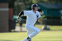 Center fielder James Fowlkes (15) of the University of South Carolina Upstate Spartans runs to first in a game against the College of Charleston Cougars on Tuesday, March 31, 2015, at Cleveland S. Harley Park in Spartanburg, South Carolina. Charleston won, 10-0. (Tom Priddy/Four Seam Images)