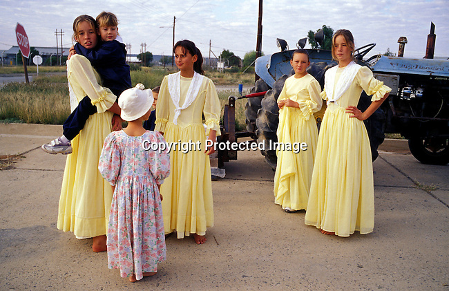 youth,girls,afrikaners,traditional,tractor,rural,country side,farming community, .Youth dressed in traditional dress in Orania, an all white Afrikaner community. They enjoy the yearly farm show on May 2, 2004 in Orania, Northern Cape, South Africa. .©Per-Anders Pettersson/iAfrika Photos