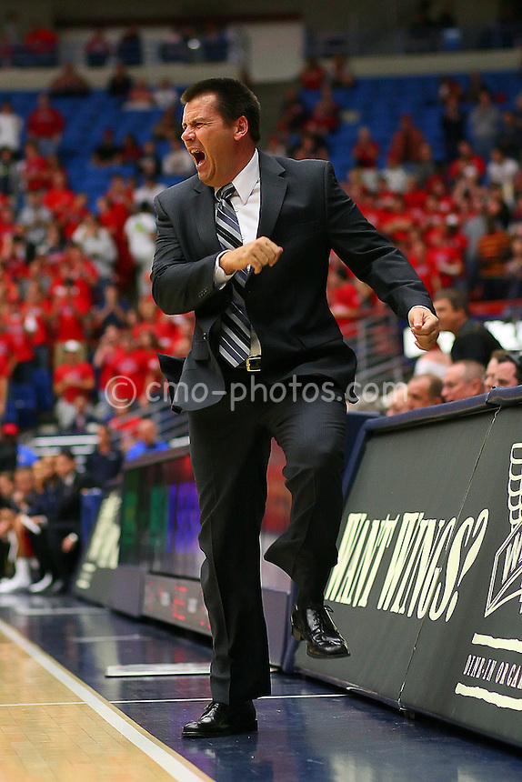 Nov 17, 2008; Tucson, AZ, USA; Arizona Wildcats head coach Russ Pennell reacts to the play of his team early in the first half of a NIT Season Tip-Off game against the Florida Atlantic Owls at the McKale Center.  Arizona won the game 75-62.  Mandatory Credit: Chris Morrison-US PRESSWIRE