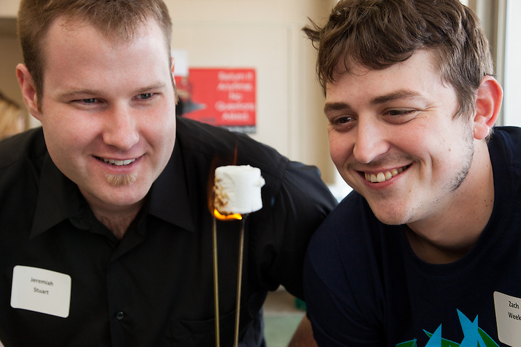 "Demonstrating their ""Lowell Jacobs Ladder"" Jeremiah Stuart and Zach Weeks of the Theatre program send 9000s volts through a coat hanger to cook marshmallows.  The lighting designers took part in the annual Student Research and Creative Activity Expo at Ohio University.  More than 800 participants from 56 departments and schools took part in the event. Photo by Ohio University / Jonathan Adams"
