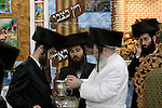 Israel, Bnei Brak. Succot holiday at the Premishlan congregation. A Tish with the Rebbe (a gathering of the Hasidim with their Rebbe). The Rebbe is washing his hands<br />