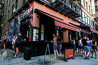 NEW YORK, NEW YORK - JUNE 18: People try to get cocktails to drink at the sidewalk in the Hells Kitchen area as city prepares for reopening on June 18, 2020 in New York City. New York City is preparing to enter phase 2 of reopening where restaurants and bars can offer outdoor dining this coming Monday. (Photo by Eduardo MunozAlvarez/VIEWpress)
