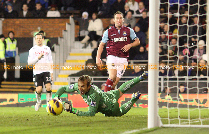 Mark Schwarzer of Fulham saves from Kevin Nolan - Fulham vs West Ham United, Barclays Premier League at Craven Cottage, Fulham - 30/01/13 - MANDATORY CREDIT: Rob Newell/TGSPHOTO - Self billing applies where appropriate - 0845 094 6026 - contact@tgsphoto.co.uk - NO UNPAID USE.