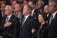 U.S. Vice President Mike Pence, former President George W. Bush and former first lady Laura Bush watch as the casket of former President George H.W. Bush arrives to lie in state in the U.S. Capitol Rotunda in Washington, U.S., December 3, 2018. <br /> CAP/MPI/RS<br /> &copy;RS/MPI/Capital Pictures
