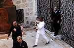 Rapper Kanye West holds his daughter after a baptism ceremony at St. James Cathedral in Jerusalem Monday, April 13, 2015. In a quick visit to Jerusalem, American reality TV star Kim Kardashian and rapper West had their toddler daughter, North West, baptized on Monday at a 12th century Armenian church in the old walled city. Photo by Saeb Awad
