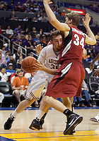 Arizona State's Rihards Kuksiks (30) drives in against Stanford's Andrew Zimmermann (34). The Stanford Cardinal, ranked 7th in the Pac-10 defeated the 2nd ranked Arizona State Sun Devils 70-61 during the Pac-10 Tournament at the Staples Center in Los Angeles, California on March 11th, 2010.