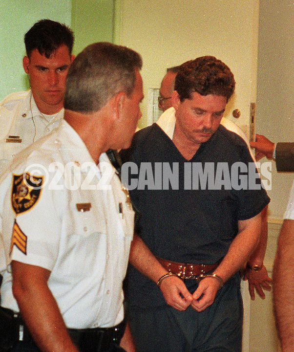 Former Norristown State Hospital nurse and murder suspect Dennis Czajkowski, right, is led to a preliminary hearing Wednesday, July 7, 1999, in Norristown, Pa. Czajkowski is charged in the shooting death of nursing supervisor Carol Kepner and the injuring of nursing supervisor Marie Jordan, both whom he held hostage for  46 hours in June.  (Photo by William Thomas Cain)