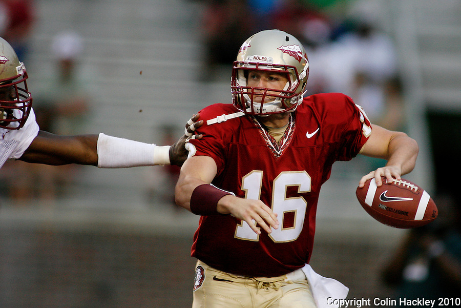 TALLAHASSEE, FL 4/10/10-FSU-SPRING FB10 CH-Garnet quarterback Will Secord is pressured by Gold's Brandon Jenkins as he scrambles during second half Spring Game action Saturday at Doak Campbell Stadium in Tallahassee. .COLIN HACKLEY PHOTO