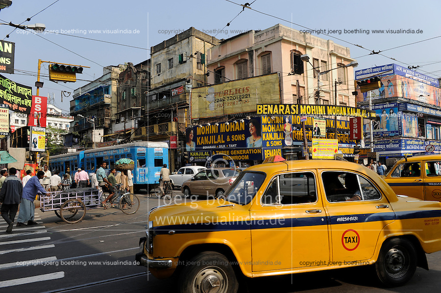 "Asien Suedasien Indien Westbengalen Megacity Kalkutta, Strassenszene mit Strassenbahn und das gelbe Ambassador Taxi , der Ambassador ist ein Nachbau des Morris Oxford und wird bei Hindustan Motors in Kalkutta  noch heute gebaut  - Verkehr xagndaz | .South asia India Westbengal Calcutta Kolkatta, city crossing with tram and Ambassador Taxi a duplikate of Morris Oxford which is still built by Hindustan Motors - traffic .| [ copyright (c) Joerg Boethling / agenda , Veroeffentlichung nur gegen Honorar und Belegexemplar an / publication only with royalties and copy to:  agenda PG   Rothestr. 66   Germany D-22765 Hamburg   ph. ++49 40 391 907 14   e-mail: boethling@agenda-fototext.de   www.agenda-fototext.de   Bank: Hamburger Sparkasse  BLZ 200 505 50  Kto. 1281 120 178   IBAN: DE96 2005 0550 1281 1201 78   BIC: ""HASPDEHH"" ,  WEITERE MOTIVE ZU DIESEM THEMA SIND VORHANDEN!! MORE PICTURES ON THIS SUBJECT AVAILABLE!!  ] [#0,26,121#]"
