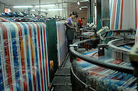 The Five Star Factory that manuactures platic bags and plastic sheeting in Nanhai, China.  The company uses recycles platic bags to make its products.<br /> <br /> Photo by Richard Jones / Sinopix