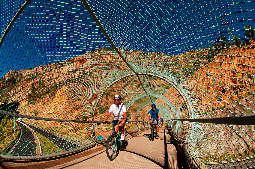 Bicycling on a bridge over Interstate 70 on the Glenwood Canyon Bicycle Path, Glenwood Springs, Colorado USA
