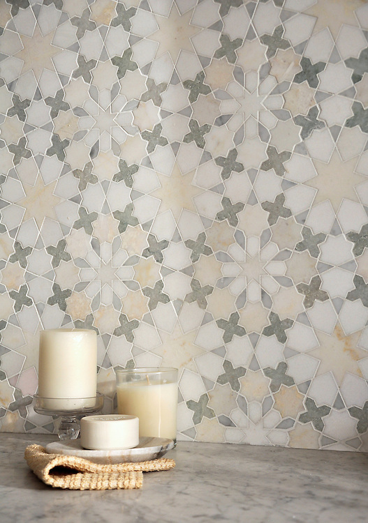 Granada, a natural stone waterjet mosaic shown in Heavenly Cream, Cloud Nine, Ming Green, Carrara, and Thassos, is part of the Miraflores collection by Paul Schatz for New Ravenna Mosaics.