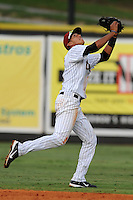 Greenville Astros shortstop Carlos Correa #12 stretches out for a line shot during a game against the Burlington Royals at Pioneer Park on August 17, 2012 in Greenville, Tennessee. The Astros defeated the Royals 5-1. (Tony Farlow/Four Seam Images).