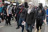 Anarchists in Oxford Street during the TUC March for the Alternative protest against public spending cuts, London.