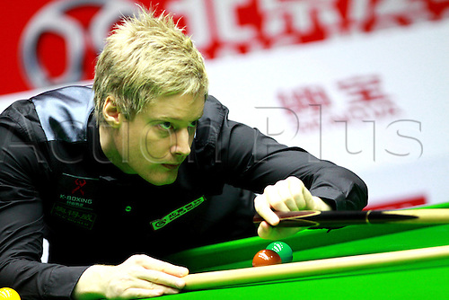 31.03.2013.  Beijing, CHINA; Robertson lines up a shot. Neil Robertson won a ranking event in China for the first time by beating Mark Selby 10-6 in the final of the Bank of Beijing China Open.