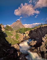Stream from Swiftcurrent Lake and Grinnell Point. Glacier National Park. Montana.