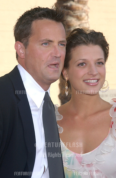 MATTHEW PERRY & girlfriend RACHEL DUNN at the 2003 Primetime Creative Arts Emmy Awards at the Shrine Auditorium, Los Angeles..Sept 13, 2003