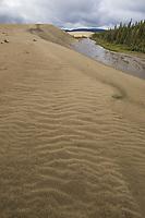 Ahnewetut Creek flows through the Great Sand Dunes in the Kobuk Valley National Park, Arctic, Alaska.