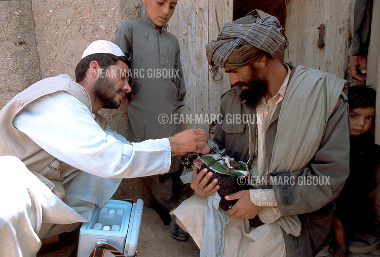 Government health workers go door to door in villages of Zendeh Jan district in Herat province during the national immunization days in Afghanistan, on April 16, 2002.(photo by Jean-Marc Giboux)