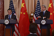 Washington, DC - February 23, 2016: U.S. Secretary of State John Kerry (r) listens as Chinese Foreign Minster Wang Yi speaks during a press availability in the Ben Franklin Room of the U.S. Department of State in the District of Columbia, February 23, 2016.  (Photo by Don Baxter/Media Images International)