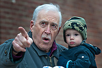 Fred Dellamura points out highlights in the Westerville Christmas Parade to his one-year-old grandsonLuke Barnes as the parade moves the Uptown.