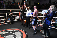 Jake Ball (black/white shorts) defeats Daryl Sharp during a Boxing Show at York Hall on 8th June 2019