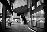 Urban Abstract: Sidewalk with curves & angles, black & white, bw, concrete structures, glass, perspective
