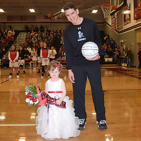 RICK PECK/SPECIAL TO MCDONALD COUNTY PRESS<br /> Flower girl Paisley Cornell is escorted by Cade Smith.