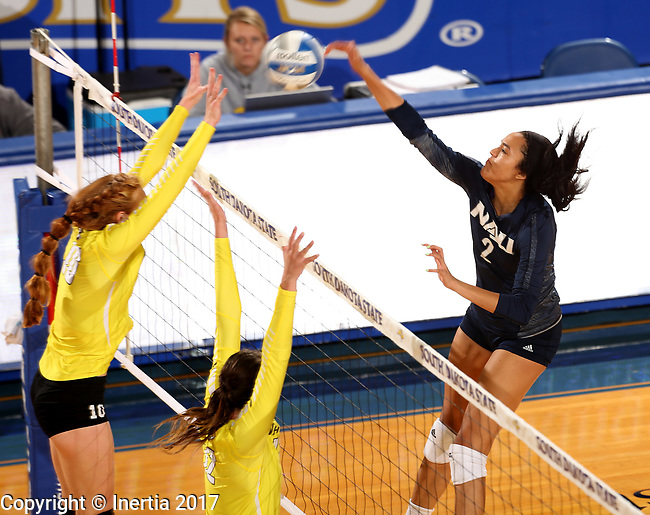 BROOKINGS, SD - SEPTEMBER 1: Victoria Ewalefo #2 from Northern Arizona looks to get a kill past Ally Cummings #16 from Valparaiso during their match Friday afternoon at the Jackrabbit Invitational at Frost Arena in Brookings. (Photo by Dave Eggen/Inertia)