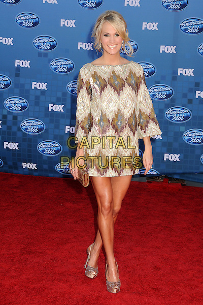 CARRIE UNDERWOOD.Arrivals to the 2011 American Idol Finale held at The Nokia Live in Los Angeles, California, USA..May 25th, 2011.full length dress green beige white print silver shoes clutch bag beads beaded sequins sequined knitted.CAP/ADM/BP.©Byron Purvis/AdMedia/Capital Pictures.