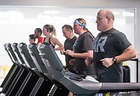 NWA Democrat-Gazette/BEN GOFF @NWABENGOFF<br /> Competitors run Saturday, March 10, 2018, while competing in the 2018 Indoor Triathlon at the Jones Center in Springdale. Participants started in waves and had 10 minutes to swim, 20 minutes on a stationary bike and 15 minutes on a treadmill to log as many miles as possible.