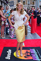Laura Aikman<br /> The &quot;Bula Quo!&quot; UK film premiere, Odeon West End cinema, Leicester Square, London, England.<br /> July 1st, 2013<br /> full length top yellow silk satin skirt white hands on hips white lace flower in hair<br /> CAP/BF<br /> &copy;Bob Fidgeon/Capital Pictures