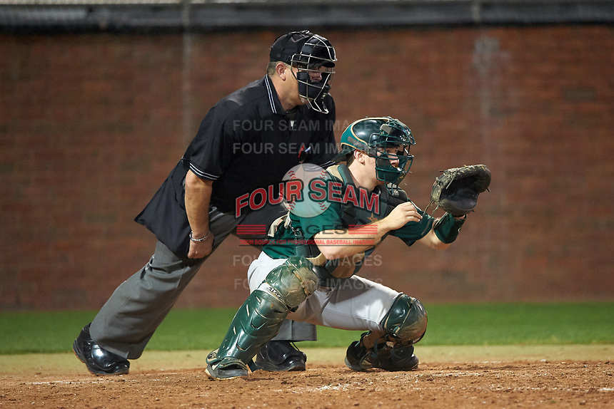 Umpire Ray Parrish and Siena Saints catcher Phil Madonna (3) await the pitch during a game against the Stetson Hatters on February 23, 2016 at Melching Field at Conrad Park in DeLand, Florida.  Stetson defeated Siena 5-3.  (Mike Janes/Four Seam Images)