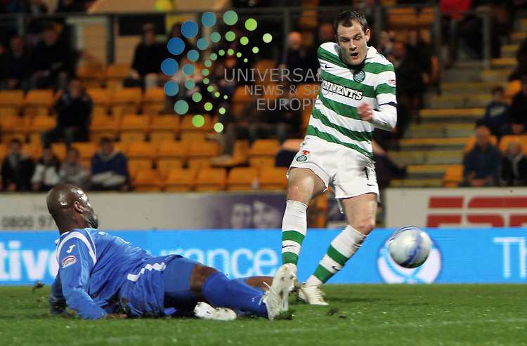 The Co-operative Insurance Cup Fourth Round, Season 2010/11.St. Johnstone Football Club  V  Celtic Football Club..27-10-10...Anthony Stokes (right) scores Celtics third goal, in this evening's  Co-operative Insurance Cup Fourth Round, tie between, St Johnsotone and Celtic...At McDiarmid Park Stadium, Perth...Picture, Craig Brown /Universal News and Sport (Scotland)..Wednesday 27th October 2010.