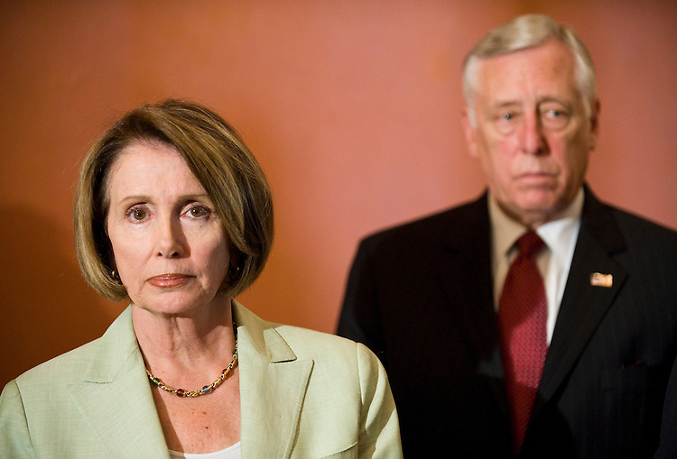 Speaker of the House Nancy Pelosi, D-Calif., and House Majority Leader Steny Hoyer, D-Md., listen as other House Democratic leaders speak at the Speaker's Balcony during their news conference on healthcare reform on Monday, July 27, 2009.