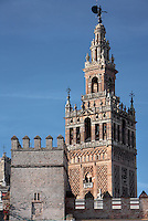 General view of Giralda Minaret, Seville Cathedral, Andalucia, Spain, pictured on December 25, 2006 in the winter afternoon light. Seville Cathedral is the largest Gothic building in the world. It was converted from the original 12th century Almohad Mosque on this site during the 16th century and the original Moorish entrance court and Giralda Minaret are both integrated in the cathedral. Inside is the tomb of the explorer Christopher Columbus (1451-1506). The Giralda is constructed of cut bricks, originally 82 metres high, now 103 metres high with the 16th century belfry added to the original tower. Picture by Manuel Cohen