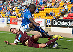 St Johnstone v Hearts...04.08.13 SPFL<br /> Dylan McGowan takes out Nigel Hasselbaink<br /> Picture by Graeme Hart.<br /> Copyright Perthshire Picture Agency<br /> Tel: 01738 623350  Mobile: 07990 594431