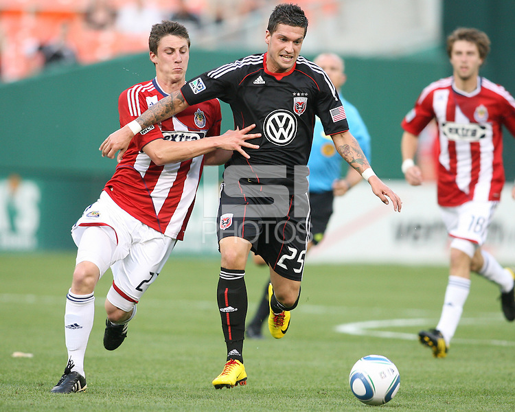 Santino Quaranta #25 of D.C. United struggles to get clear of Ben Zemanski #21 of Chivas USA during an MLS match at RFK Stadium, on May 29 2010 in Washington DC. United won 3-2.