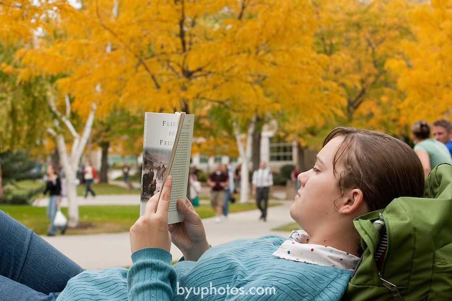 0610-01 BYU General Campus Scenics..GCS..Student reading book on south campus, fall trees in background..October 2, 2006..Photography by Jaren Wilkey/BYU..Copyright BYU Photo 2006.All Rights Reserved.photo@byu.edu   (801)422-7322
