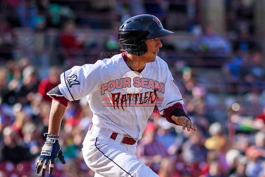 Wisconsin Timber Rattlers outfielder Ryan Aguilar (21) races to first during a Midwest League game against the Quad Cities River Bandits on April 8, 2017 at Fox Cities Stadium in Appleton, Wisconsin.  Wisconsin defeated Quad Cities 3-2. (Brad Krause/Four Seam Images)