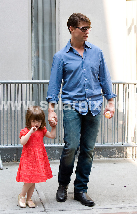 **ALL ROUND PICTURES FROM SOLARPIX.COM**.**SYNDICATION RIGHTS FOR UK, SPAIN, PORTUGAL, AUSTRALIA, S.AFRICA & DUBAI (U.A.E) ONLY**.Tom Cruise, Katie Holmes and Suri Cruise in Manhattan on August 15, 2008..This pic: Suri and Tom Cruise..JOB REF: 7042 PHZ/Mayer   DATE: 15_08_2008.**MUST CREDIT SOLARPIX.COM OR DOUBLE FEE WILL BE CHARGED* *UNDER NO CIRCUMSTANCES IS THIS IMAGE TO BE REPRODUCED FOR ANY ONLINE EDITION WITHOUT PRIOR PERMISSION*