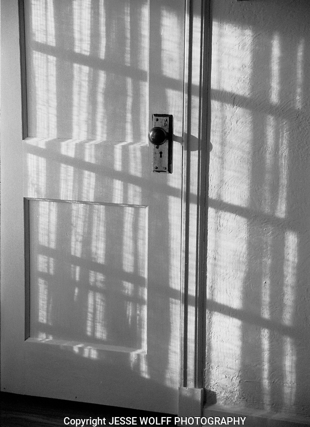 Afternoon shadows hitting a wooden door in my old house...