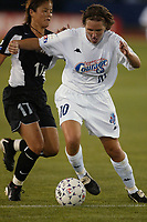 Hege Riise of the Carolina Courage gets past Ronnie Fair of the New York Power. The Courage defeated the Power 2-1 on Wednesday August 7th at Mitchel Athletic Complex, Uniondale, NY.