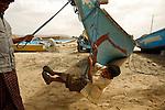 .Young boy playing on the  Qalantsiya beach. Socotra. Yemen