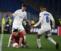 Football Soccer: UEFA Europa League round of 32 first leg AS Roma vs KAA Gent, Olympic stadium, Rome, 20 February, 2020.<br /> Roma's Diego Perotti (bottom) in action with Gent's Mikael Lustig (up) and captain Vadis Odjidja (r) during the Europa League football match between Roma and Gent at the Olympic stadium in Rome on 20 February, 2020.<br /> UPDATE IMAGES PRESS/Isabella Bonotto