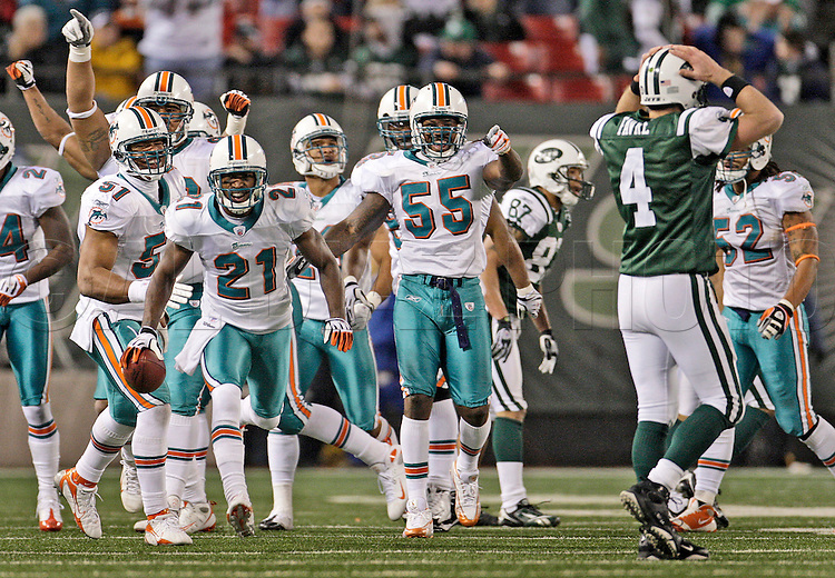 Miami's Andre Goodman (21) and teammates taunt Jet's quarterback Brett Favre after Goodman intercepts Favre's pass in the fourth quarter. The Miami Dolphins vs New York Jets