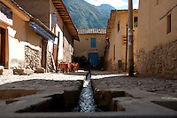 Town of Ollantaytambo, in southern Peru, is home to an important  Inca archeological site. The town was built on top of original Inca foundations divided into canchas (blocks), each leading into a central courtyard. The town displays how Inca terracing and irrigation took place in the Urubamba Valley. Because of its success, the Inca irrigation system is still used by villagers for cultivation to this day.