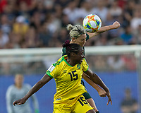 GRENOBLE, FRANCE - JUNE 18: Tiffany Cameron #15 of the Jamaican National Team, Alanna Kennedy #14 of the Australian National Team battle for head ball during a game between Jamaica and Australia at Stade des Alpes on June 18, 2019 in Grenoble, France.